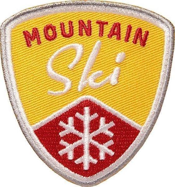 Mountain Ski Wintersport Aufnäher von Club of Heroes. Gelb